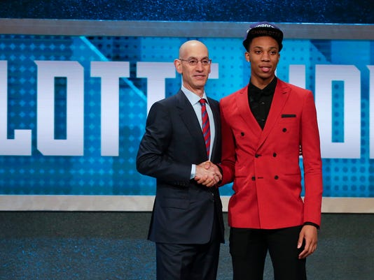 Malachi Richardson, right, poses for a photo with NBA Commissioner Adam Silver after being selected 22nd overall by the Charlotte Hornets during the NBA basketball draft, Thursday, June 23, 2016, in New York. (AP Photo/Frank Franklin II)
