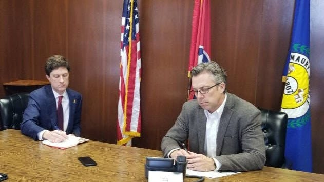 Columbia Mayor Chaz Molder, left, and Maury County Mayorl Andy Ogles, right, sit in on a conference call with with Tennessee Gov. Bill Lee regarding the coronavirus on Wednesday, March 18, 2020.