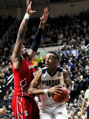 Vince Edwards is met by Marcel Boyd of Howard along the baseline Wednesday, December 9, 2015, at Mackey Arena. Purdue thumped Howard 93-55.