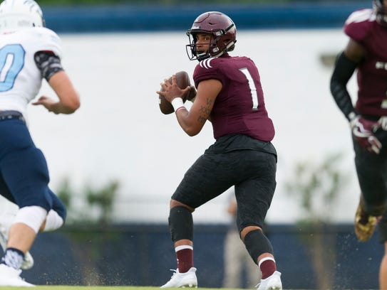 Fulton's Xavier Malone (1) looks to pass during the