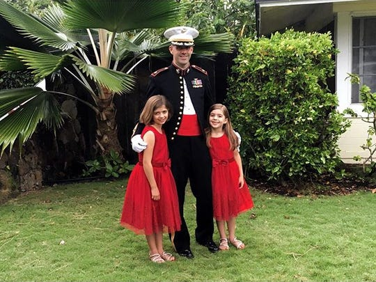 Maj. Shawn Campbell with his two daughters dressed