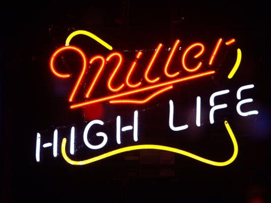 "File"" A Miller beer sign hangs in a bar. (Photo by Scott Olson/Getty Images)"