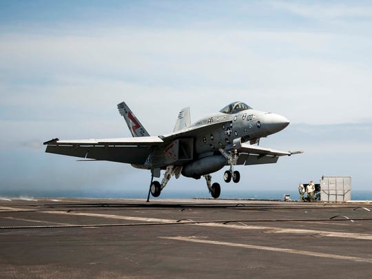 """Salty Dog 100,"" an F/A-18F Super Hornet assigned to"