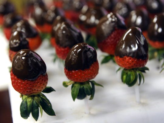 Edible Arrangements offers hand-dipped chocolate-covered strawberries.