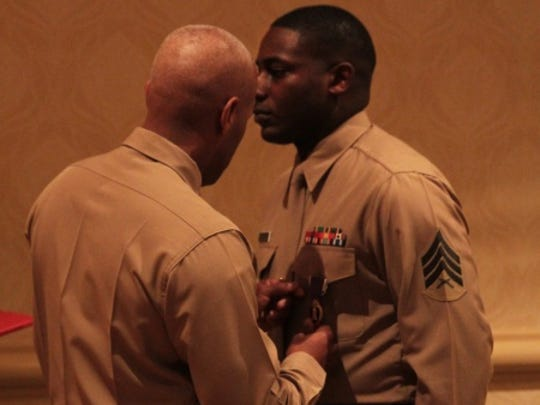 Sgt. DeMonte R. Cheeley is presented the Purple Heart