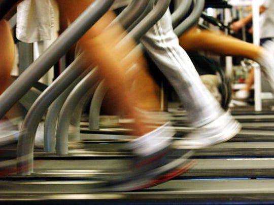 BROOKLYN, NEW YORK - JANUARY 2:  People run on treadmills
