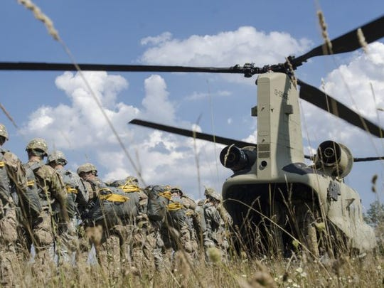 Paratroopers from the 173rd Airborne Brigade load into