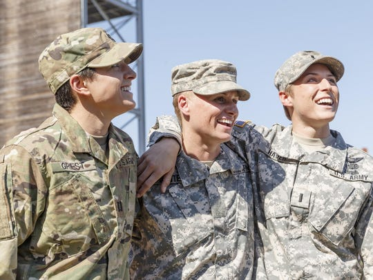 Maj. Lisa Jaster, center, becomes the third woman to