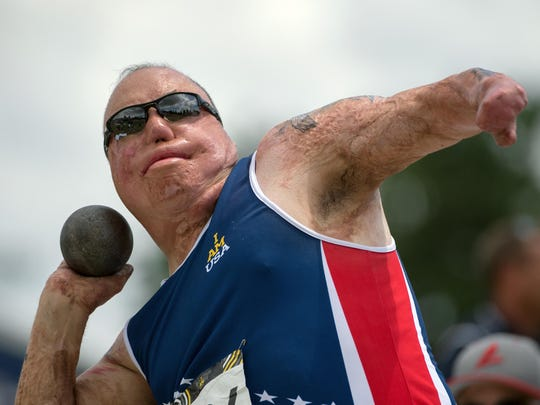Master Sgt. Israel Del Toro throws a shotput during