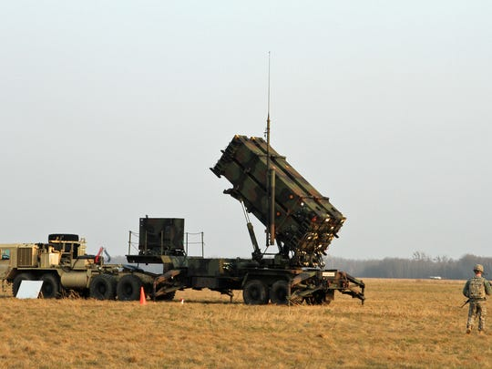 A US soldier stands guard near a Patriot launcher on