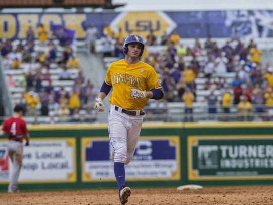 St. Thomas More High product O'Neal Lochridge, now playing for UL, rounds the bases after homering for LSU in 2016.