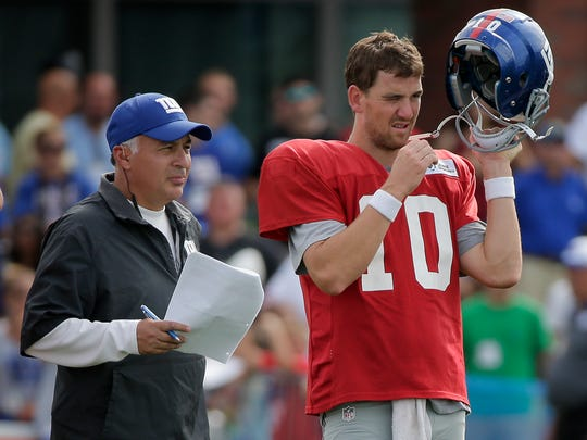 Giants offensive coordinator Mike Sullivan, seen here in a file photo speaking with quarterback Eli Manning, called the plays for the team in last Sunday's stunning victory over the Broncos.