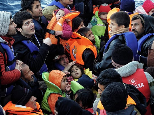 Children are among the refugees and migrants on a rubber