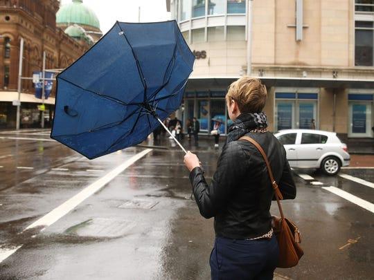 An umbrella in the wind