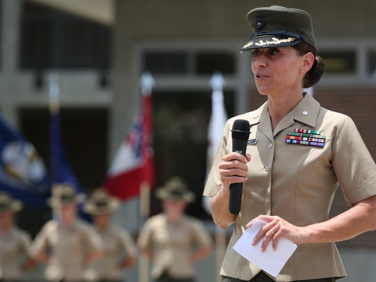 Lt. Col. Kate Germano addresses an audience during