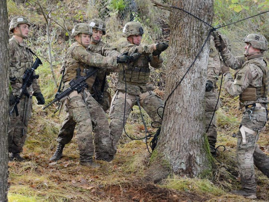 Soldiers, assigned to 1st Armored Brigade Combat Team,