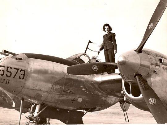 Dorothy Olsen, seen on a P-38 Lightning, during her