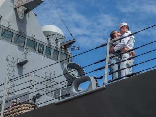 Operations Specialist Jacob Cowger kisses his wife