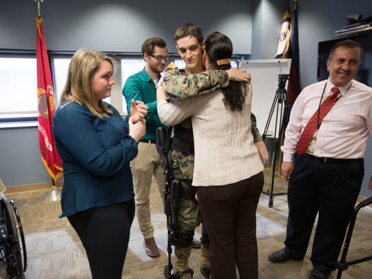 Burch hugs his mother, Emily Burch, after his promotion
