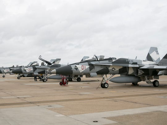The squadron's Hornets are camouflaged with gray and