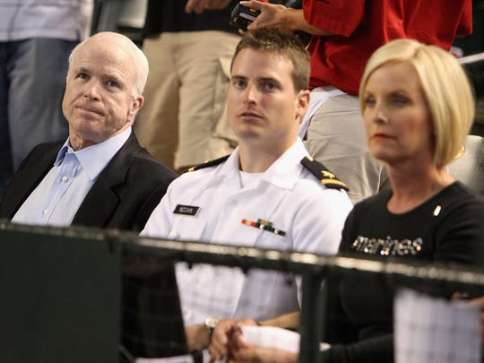 Lt. Jack McCain, an ensign in 2009, attended a baseball game with his parents shortly after graduating from the Naval Academy.