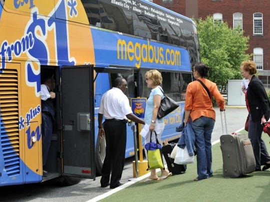 Passengers board a Megabus