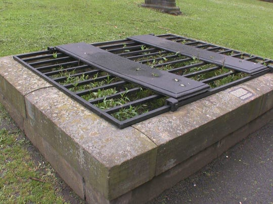 Families built secure graves like this Mort Safe at