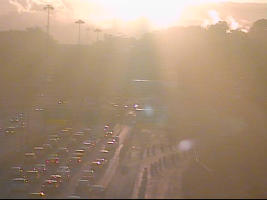 Drivers dealing with sun glare into downtown on I-90.