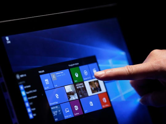 A visitor tries out Microsoft Corp.'s Windows 10 operating