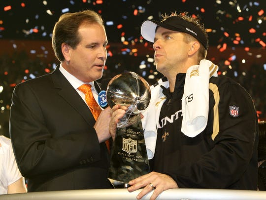 Feb 7, 2010; Miami, FL, USA; New Orleans Saints head coach Sean Payton holds the Lombardi Trophy and talks to CBS broadcaster Jim Nantz after defeating the Indianapolis Colts 31-17 in Super Bowl XLIV at Sun Life Stadium. Mandatory Credit: Matthew Emmons-USA TODAY Sports
