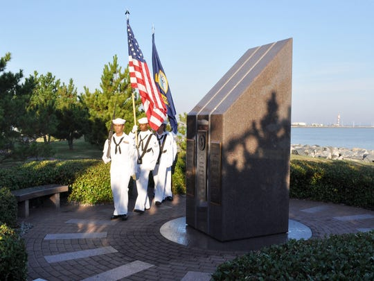A Navy honor guard from the destroyer Cole practices
