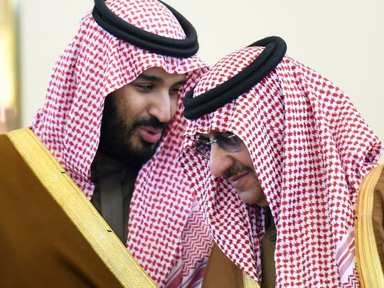 Saudi Defence Minister Mohamed bin Salman, left, talks