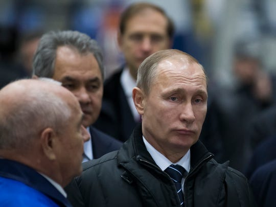 Russian President Vladimir Putin, right,  visits the