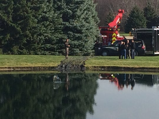 A car was pulled from a pond Tuesday morning.