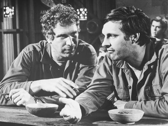 Wayne Rogers and co-star Alan Alda in a scene from the 70's television comedy M*A*S*H.