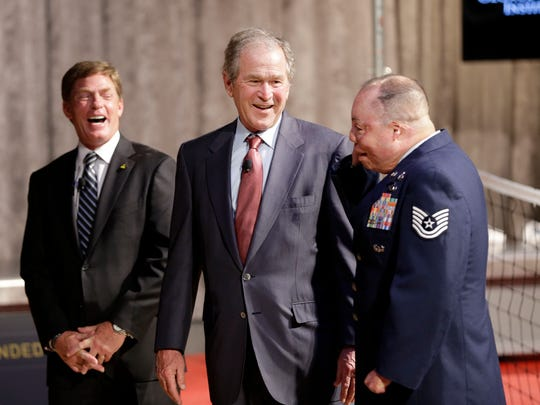 Former President George W. Bush, center, and Invictus