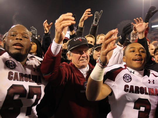 Steve Spurrier celebrates with his players.