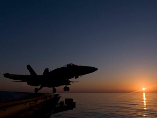 An F/A-18C Hornet launches from an aircraft carrier
