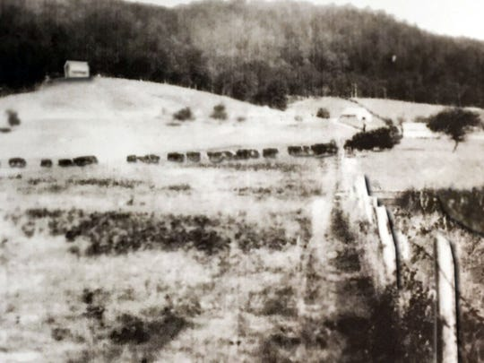 The Myers family farm and house on the hill in Cades Cove in the 1930s.