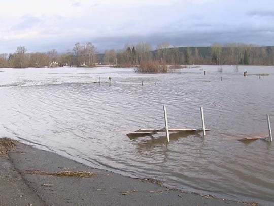 The Snoqualmie River in Carnation was cresting Thursday