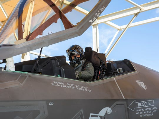 "Maj. Raven ""Rost"" LeClair checks his F-35 jet before"
