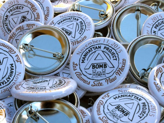 Commemorative buttons were handed out to community