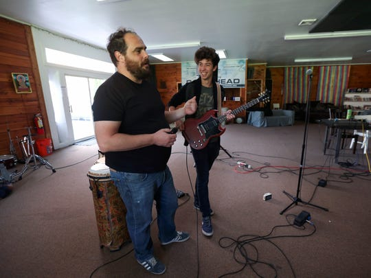 Paul Green, left, talks with student Diggy Lessard, son of Dave Matthews Band bass player Stefan Lessard, at the Paul Green Rock Academy in Saugerties.
