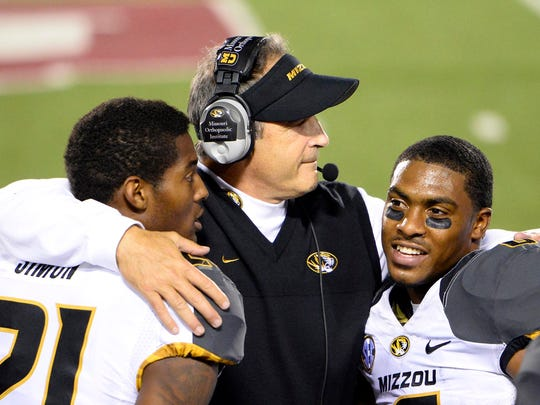 A rarity in college football: Gary Pinkel (middle) kept the same staff together at Missouri for eight seasons.