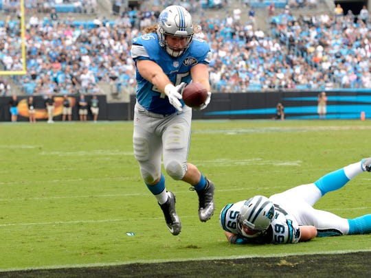 CHARLOTTE, NC - SEPTEMBER 14:  Jed Collins #45 of the Detroit Lions scores a touchdown in the 3rd quarter against the Carolina Panthers during their game at Bank of America Stadium on September 14, 2014 in Charlotte, North Carolina.  (Photo by Grant Halverson/Getty Images)