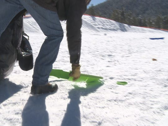 Workers at Wing Mountain Snow Play Area clean up broken