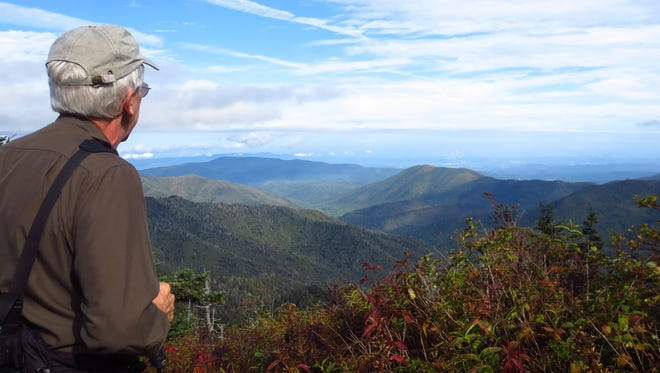 A hiker checks out the view from Clingmans Dome in the Great Smoky Mountains National Park last fall.