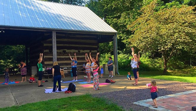 A group practices yoga with instruction from Bliss Yoga during Live, Love, Latch last year.