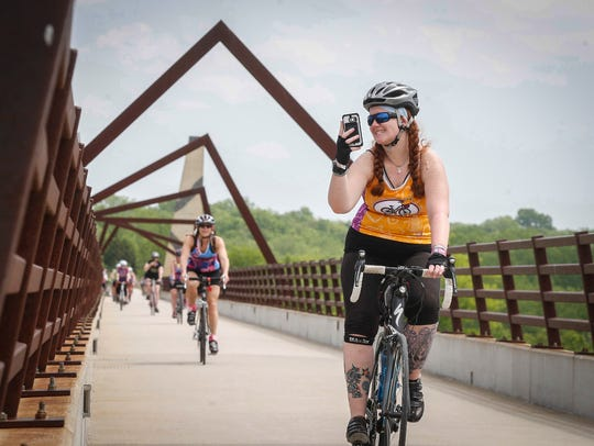 A cyclists snaps a selfie on the High Trestle Trail