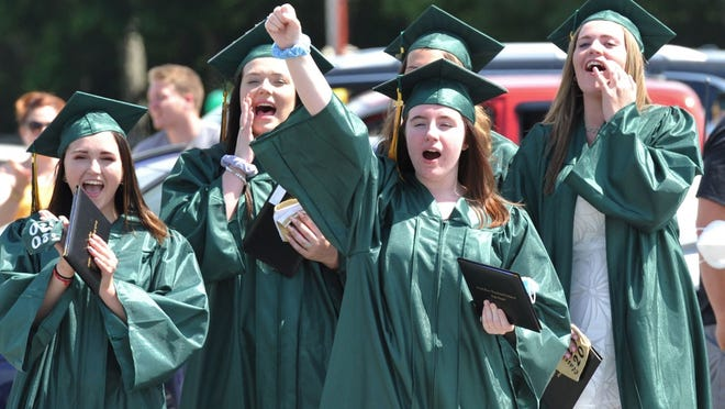 Haley Demling of Whitman, center, leads a cheer during the South Shore Vocational Technical High School graduation at the Marshfield Fairgrounds on Saturday, June 27, 2020. Tom Gorman/For The Patriot Ledger
